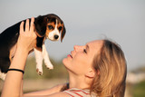 woman with pet beagle dog