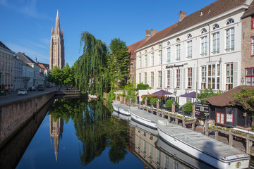 Bruges -  Look to canal with the tower of Our Lady church