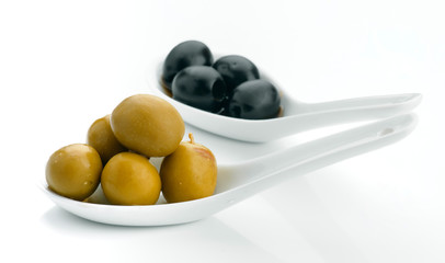 black and green olives in white bowls