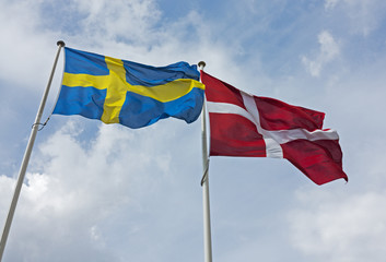 Danish and Swediah flags side by side.