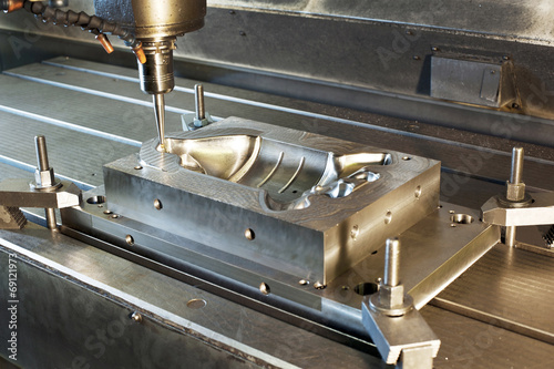 Industrial metal mold/blank milling. CNC technology.