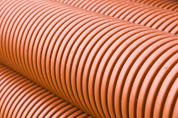 Orange PVC pipes on construction site.