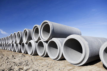 Concrete pipes on construction site.