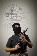 Man with gun. City map.