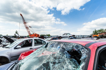 Smashed windscreen on destroyed car at scrap yard