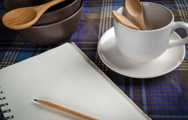 concept of cooking table with note book for cooking plan