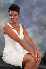 black woman sitting and smiling at the camera