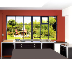 Loft kitchen and windows frames with dining table, chairs and pa