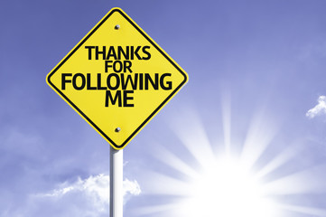 Thanks for Following Me road sign with sun background