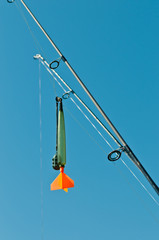 tackle for carp fishing (marker) on blue sky background
