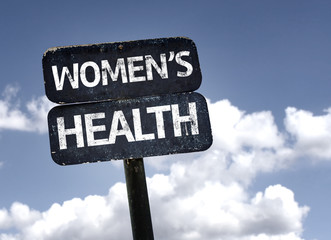 Women's Health sign with clouds and sky background