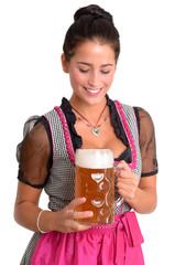 Frau im Dirndl mit Bierkrug