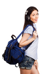 Young pretty student with a backpack and headphones