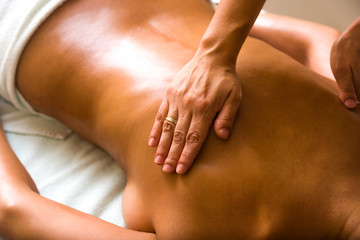 woman receiving professional massage.