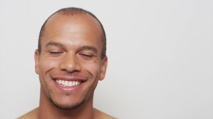 Portrait of a mixed race man smiling to camera