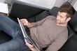 canvas print picture - Mann auf der Couch