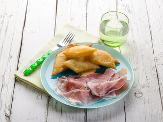 gnocco fritto with parma ham, traditional parma recipe