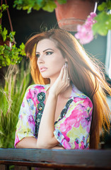 Beautiful female portrait with long red hair outdoor