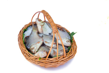 Wattled basket with hooked fish on a white background.