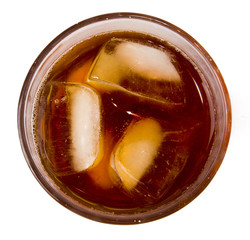 glass with ice tea full with ice cubes on white background