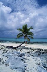 Caribbean Sea, Belize, woman on the beach of an island