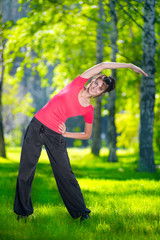 Stretching woman in outdoor sport exercise.