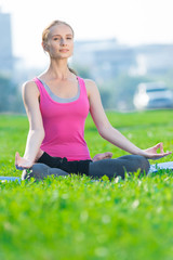 Woman doing stretching fitness exercise Yoga. lotus