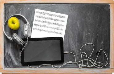 Tablet  and headphones.