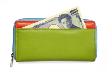 japanese yen banknotes in colorful leather wallet