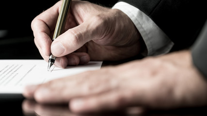 Desaturated image of signing a contract