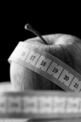 Tape measure wound around an apple
