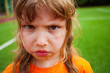 canvas print picture - Sad angry girl portrait looking straight