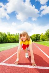 Smiling girl in uniform ready to run marathon
