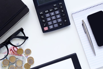 Workplaces, diary with calculator and money