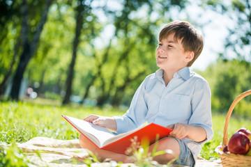 Boy in summer park