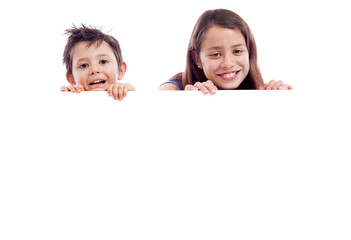 Kids holding a white board for text or image, isolated on white