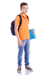 Smiling school boy with backpack holding notebooks, isolated on