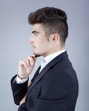 profile of handsome man on gray background