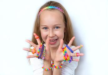 Loom bangs. Little girl demonstrated her craft workLoom bangs. L