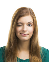 Beautiful young woman blinking eye