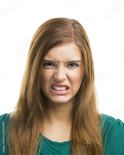 canvas print picture Young woman with a disgusting face