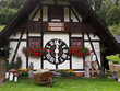 Leinwanddruck Bild - Clock House in Bavaria, Germany