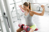 Fototapety Young woman training in the gym