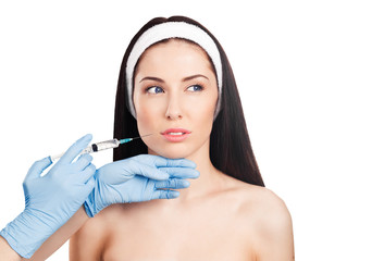 Cosmetic injection in the young woman face