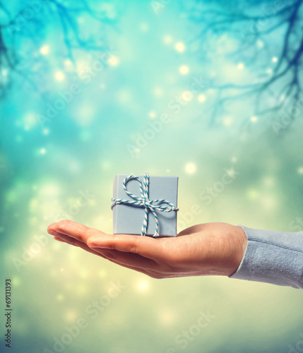 canvas print picture Presenting a small blue gift box