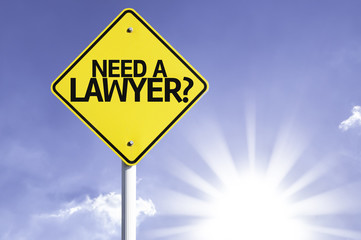 Need a Lawyer? road sign with sun background