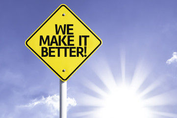 We Make It Better! road sign with sun background