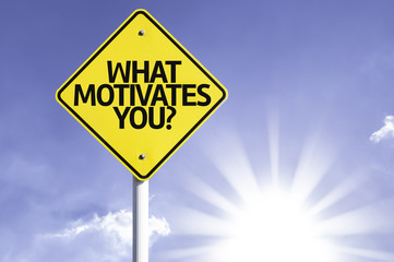 What Motivates You? road sign with sun background
