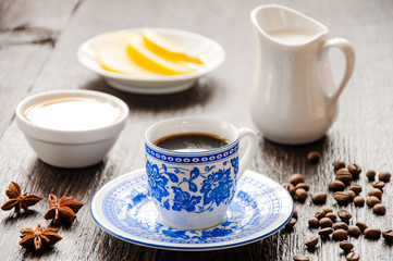 espresso in blue cup with lemon and honey on table