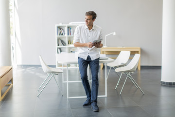 Young man with tablet in the office